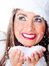 Winter woman with snow falling in her hands celebrating a white Christmas